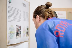 Visitor reads exhibition panels in the Ways of Working exhibition