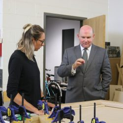 Participant on the Making It training programme explains her furniture design to WECA Regional Mayor Tim Bowles at KWMC: The Factory