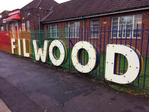 The large scale Filwood letters on the railings at Filwood Community Centre